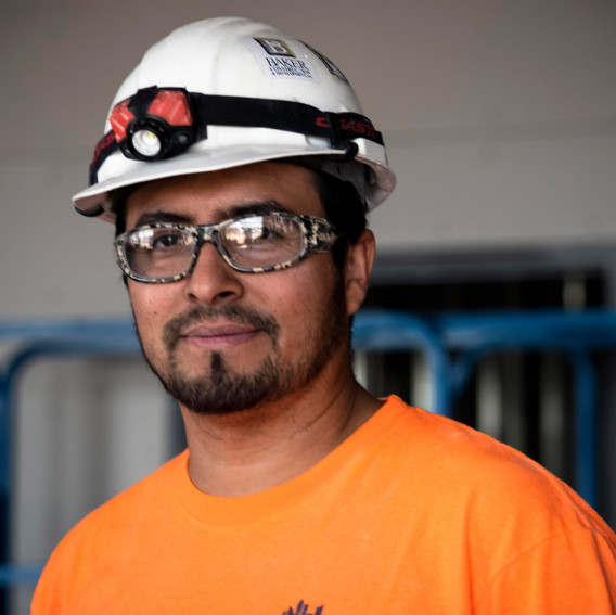 worker in orange shirt and hardhat